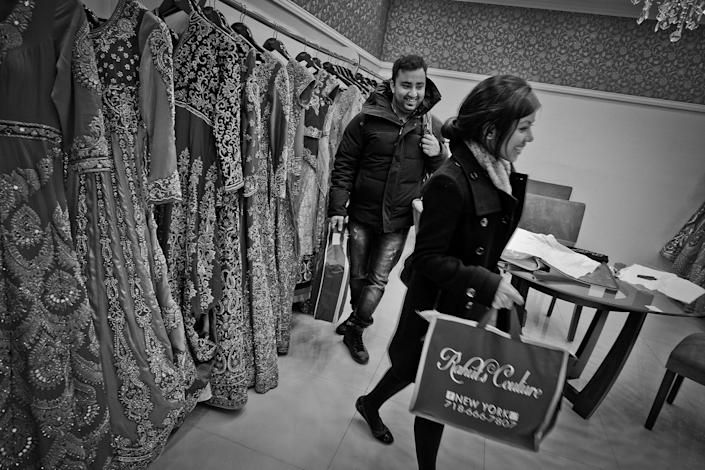 <p>Bride to be Rokshana Parvin and her fiancé Ronok Chowdhury at the Rahul's Couture bridal dress shop on 74th Street in Jackson Heights, Queens, N.Y., in December 2015. The store is Indian owned. (Photo: Yunghi Kim/Contact Press Images) </p>