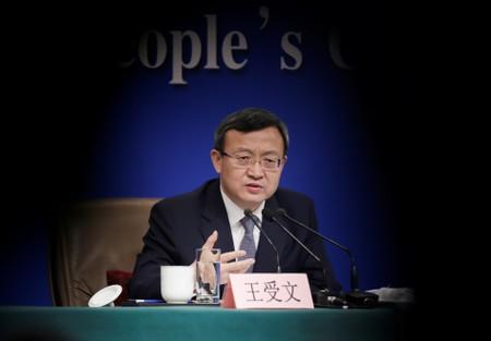 FILE PHOTO: Chinese Vice Commerce Minister and Deputy China International Trade Representative Wang Shouwen attends a news conference during ongoing session of the NPC in Beijing