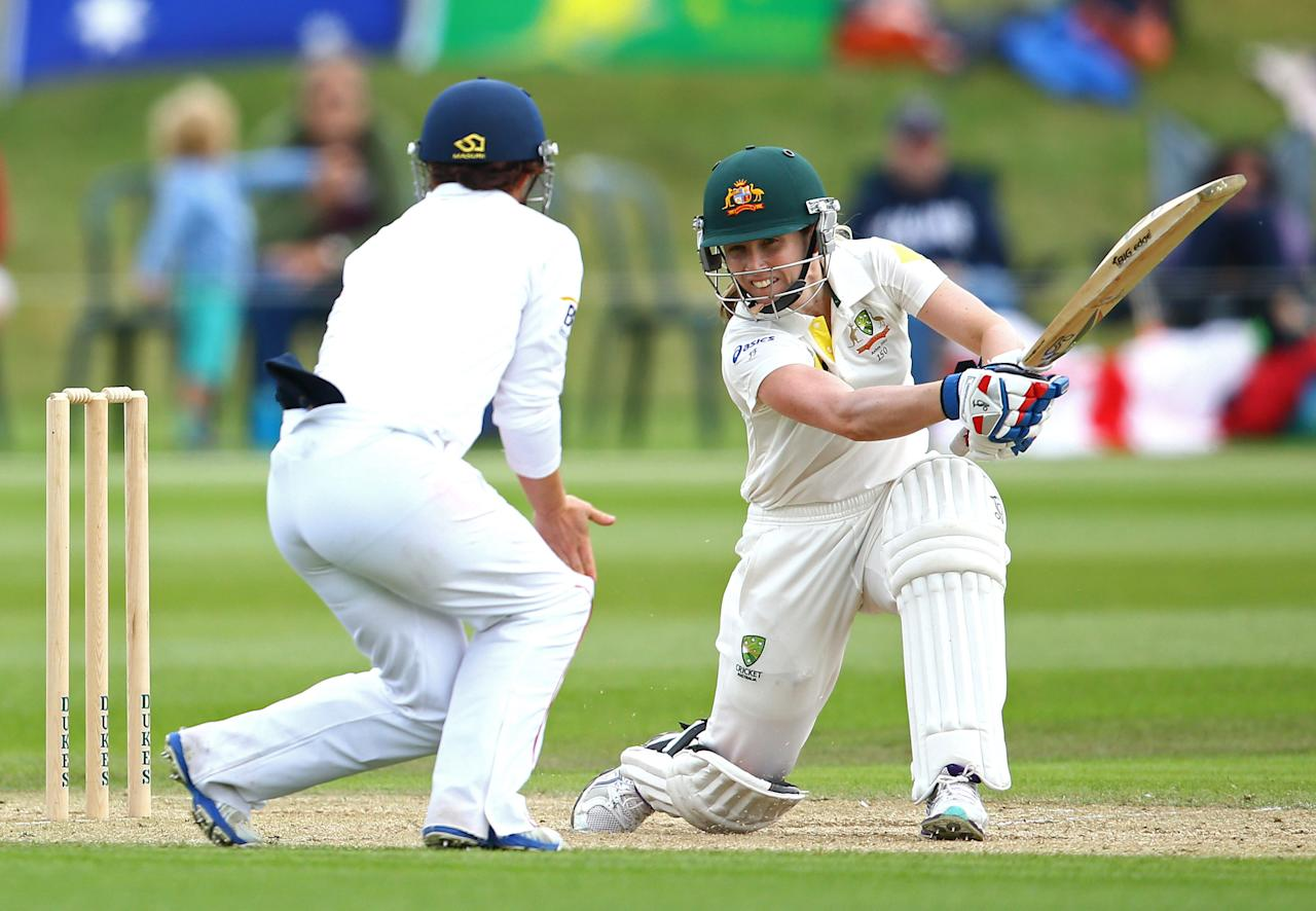 HIGH WYCOMBE, ENGLAND - AUGUST 14:   Jodie Fields of Australia hits out during day four of the Women's Ashes Series match between England and Australia at Wormsley Cricket Ground on August 14, 2013 in High Wycombe, England.  (Photo by Jan Kruger/Getty Images)