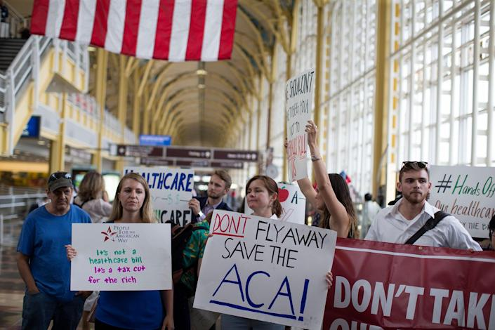 <p>Protesters greet senators leaving Ronald Regan Washington National Airport in Terminal B on June 22, 2017 in Washington. People came out to voice their views on the upcoming Healthcare vote on Capital Hill maybe as soon as next week. (Photo:Tasos Katopodis/Getty Images) </p>