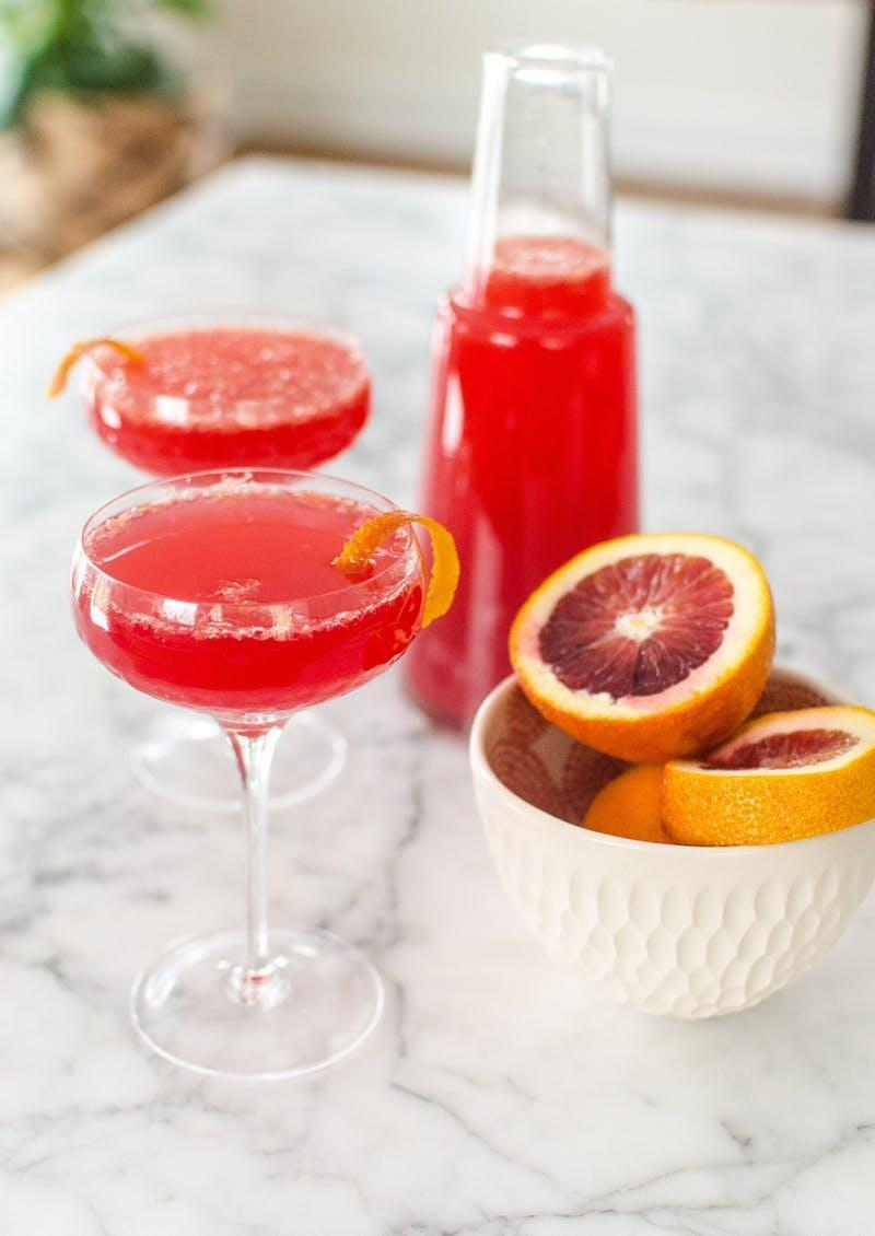 """<h2>Blood Orange Mimosa</h2> <p><strong>Recipe author: <a href=""""http://www.thekitchn.com/recipe-blood-orange-mimosa-pitcher-recipes-from-the-kitchn-215615"""" rel=""""nofollow noopener"""" target=""""_blank"""" data-ylk=""""slk:The Kitchn"""" class=""""link rapid-noclick-resp"""">The Kitchn</a></strong></p> <p><strong>Serves: </strong>8</p> <p><strong>Ingredients:</strong><br> 2 1/2 cups blood orange juice<br> 1 bottle dry sparkling wine<br> 8 to 10 blood orange twists, for garnish</p> <p><strong>Directions:</strong><br> Full recipe instructions can be found <a href=""""http://www.thekitchn.com/recipe-blood-orange-mimosa-pitcher-recipes-from-the-kitchn-215615"""" rel=""""nofollow noopener"""" target=""""_blank"""" data-ylk=""""slk:here"""" class=""""link rapid-noclick-resp"""">here</a>.</p> <h4>Faith Durand</h4>"""