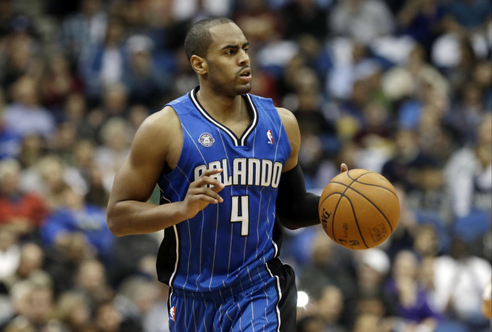 Orlando Magic's Arron Afflalo dribbles the ball in the second half of an NBA basketball game against the Minnesota Timberwolves, Wednesday, Oct. 30, 2013 in Minneapolis. The Timberwolves won 120-115 in overtime. (AP Photo/Jim Mone)