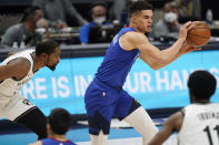 Denver Nuggets forward Michael Porter Jr. looks to pass the ball as Brooklyn Nets forward Kevin Durant, left, and guard Kyrie Irving defend during the first half of an NBA basketball game Saturday, May 8, 2021, in Denver. (AP Photo/David Zalubowski)