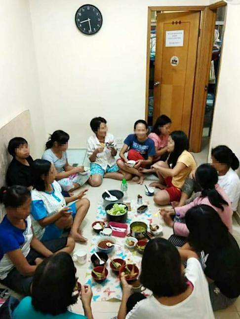 Domestic helpers have lunch at a boarding house. Photo: Handout