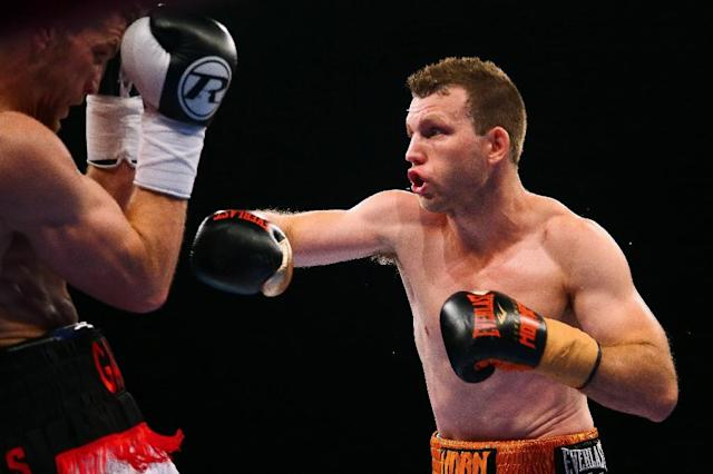 World Boxing Organisation welterweight champion Jeff Horn (R) brushed aside any doubts surrounding a short lead-up to his title defence in Vegas next month against undefeated American Terence Crawford (AFP Photo/Patrick HAMILTON)