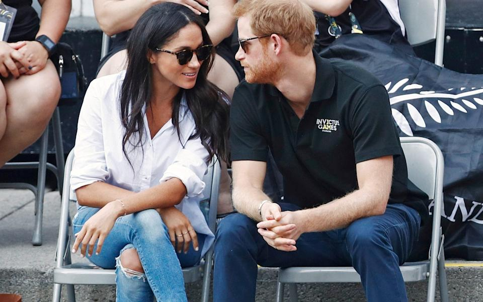 Meghan wearing Misha Nonoo's Husband shirt in Canada - Reuters