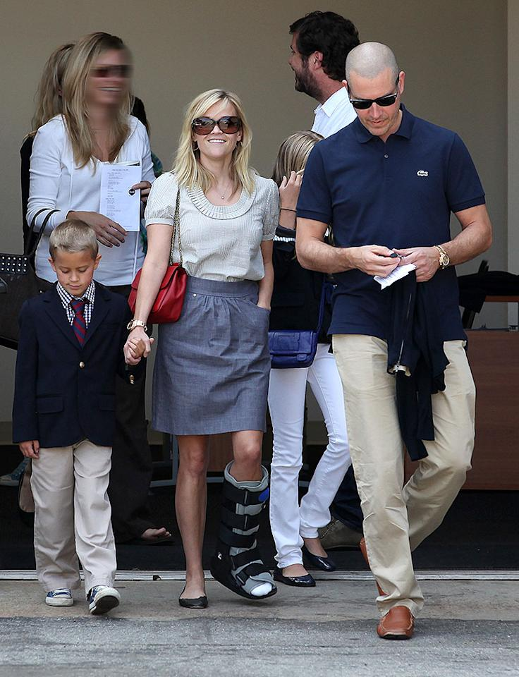 Reese Witherspoon wearing a strapping on her foot and coming out of a church with the whole family, husband Jim Toth, her daughter Ava and son, Deacon, in Los Angeles, California .