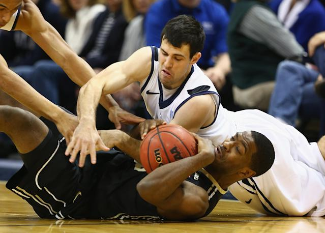 INDIANAPOLIS, IN - DECEMBER 14: Alex Barlow #3 of the Butler Bulldogs and Rapheal Davis #35 of the Purdue Boilermakers battle for a loose ball during the 2013 Crossroads Classic at Bankers Life Fieldhouse on December 14, 2013 in Indianapolis, Indiana. (Photo by Andy Lyons/Getty Images)
