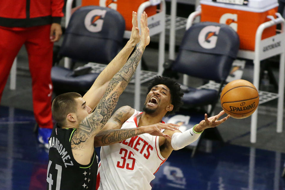 Houston Rockets center Christian Wood (35) loses control of the ball on a shot against Minnesota Timberwolves forward Juancho Hernangomez (41) in the first quarter during an NBA basketball game, Friday, March 26, 2021, in Minneapolis. (AP Photo/Andy Clayton-King)