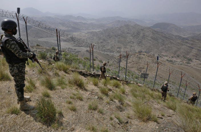 Pakistan Army troops patrol along the fence on the Pakistan Afghanistan border at Big Ben hilltop post in Khyber district, Pakistan, Tuesday, Aug. 3, 2021. Pakistan's military said it completed 90 percent of the fencing along the border with Afghanistan, vowing the remaining one of the most difficult tasks of improving the border management will be completed this summer to prevent any cross-border militant attack from both sides. (AP Photo/Anjum Naveed)