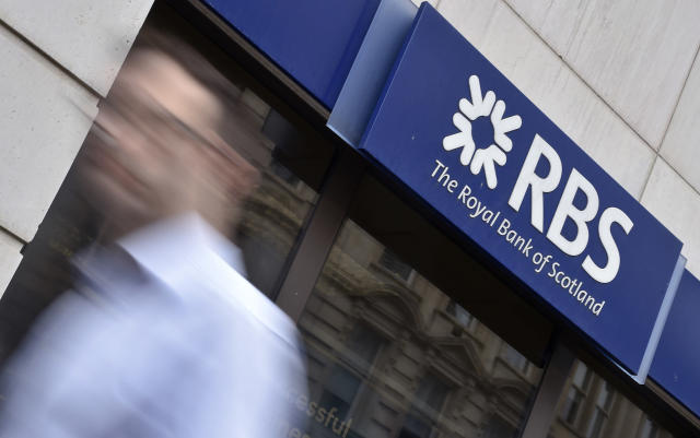 A man walks past a branch of The Royal Bank of Scotland (RBS) in central London August 27, 2014. Photo: REUTERS/Toby Melville/File Photo