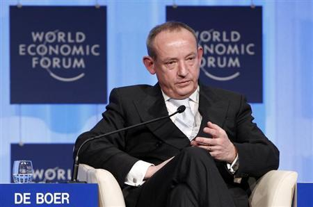 Head of the U.N. Climate Change Secretariat Yvo de Boer listens during a plenary session at the WEF in Davos