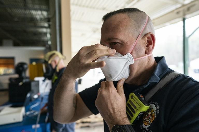 A firefighter with Anne Arundel County Fire Department in Maryland tests his N-95 mask