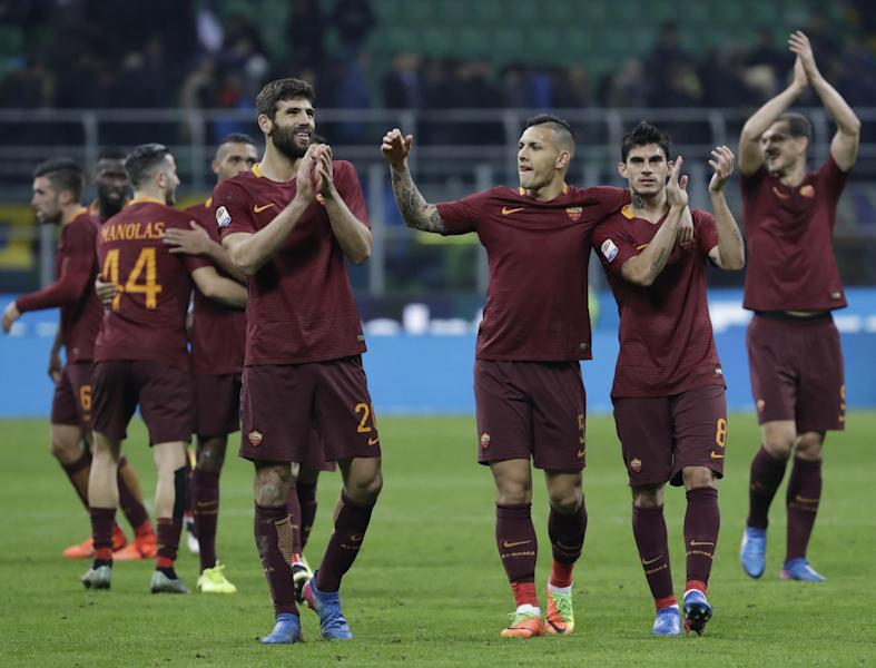 Roma players celebrate at the end of an Italian Serie A soccer match between Inter Milan and Roma, at the San Siro stadium in Milan, Italy, Sunday, Feb. 26, 2017. Roma won 3 - 1. (AP Photo/Luca Bruno)