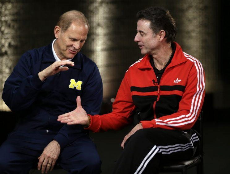 Michigan's John Beilein and Louisville's Rick Pitino met in the 2013 national title game. (AP)