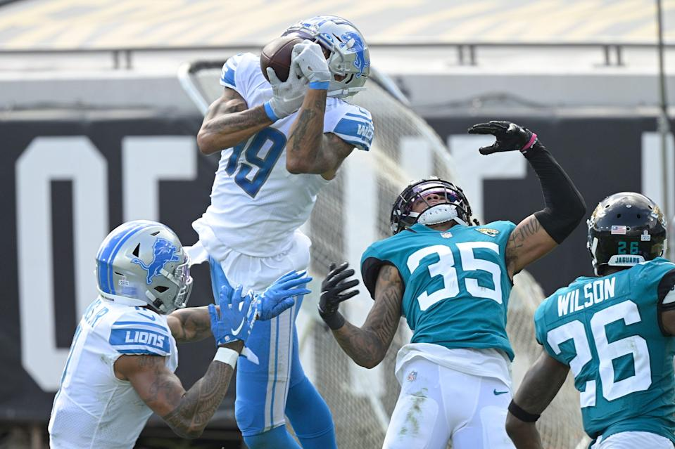 Detroit Lions receiver Kenny Golladay makes a reception over Jacksonville Jaguars cornerback Sidney Jones during the second half Oct. 18, 2020, in Jacksonville.