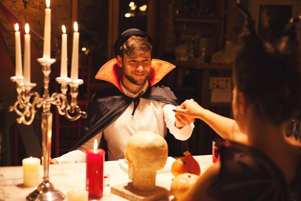 """<p>For a fang-tastic Halloween, invite your pals over for a """"vampires only"""" dinner party. Slay the menu by sticking to dishes that primarily utilize red foods: tomatoes, cranberries, beets, etc. Check out <em><a href=""""https://www.amazon.com/Love-First-Bite-Complete-Cookbook/dp/1440503583?tag=syn-yahoo-20&ascsubtag=%5Bartid%7C10072.g.28787574%5Bsrc%7Cyahoo-us"""" rel=""""nofollow noopener"""" target=""""_blank"""" data-ylk=""""slk:Love at First Bite: The Complete Vampire Lover's Cookbook"""" class=""""link rapid-noclick-resp"""">Love at First Bite: The Complete Vampire Lover's Cookbook </a></em>for more inspiration. </p><p><a class=""""link rapid-noclick-resp"""" href=""""https://www.amazon.com/Cookie-Cutter-Set-3-Pkg-Vampire/dp/B007SQ4Y6U/?tag=syn-yahoo-20&ascsubtag=%5Bartid%7C10072.g.28787574%5Bsrc%7Cyahoo-us"""" rel=""""nofollow noopener"""" target=""""_blank"""" data-ylk=""""slk:SHOP VAMPIRE COOKIE CUTTERS"""">SHOP VAMPIRE COOKIE CUTTERS</a></p>"""