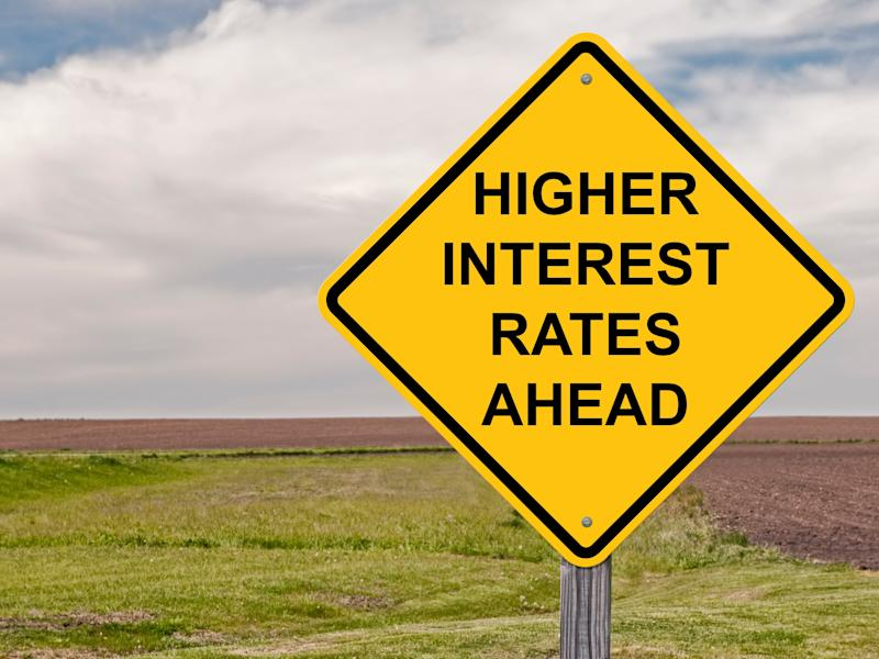 I road sign that reads higher interest rates ahead.