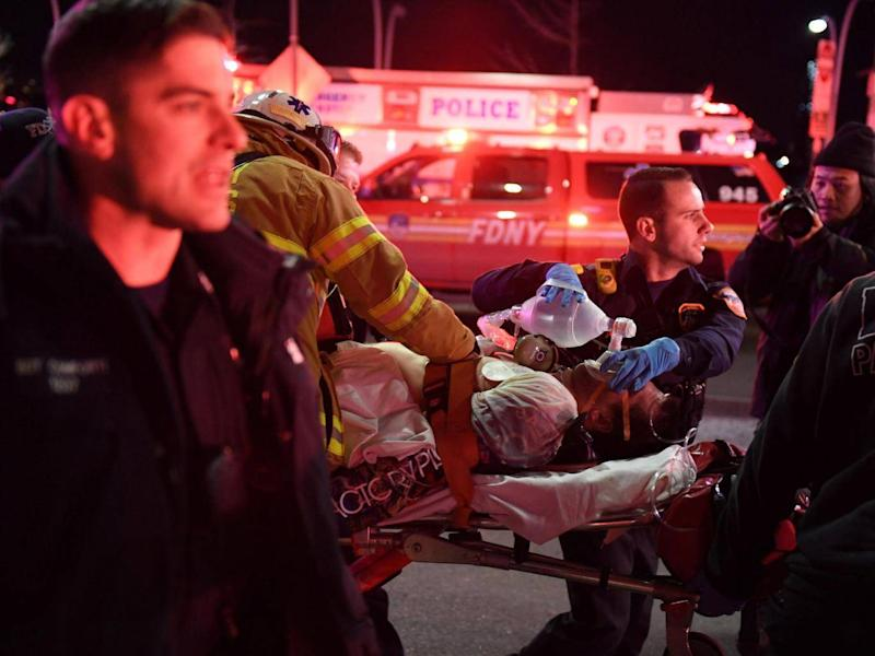 Paramedics and members of the NYFD perform CPR on a victim of the helicopter crash in New York. (REUTERS/Darren Ornitz)