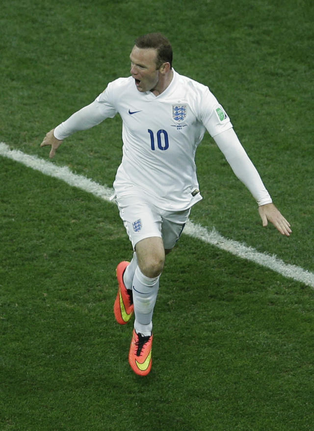 England's Wayne Rooney celebrates scoring his side's first goal during the group D World Cup soccer match between Uruguay and England at the Itaquerao Stadium in Sao Paulo, Brazil, Thursday, June 19, 2014. (AP Photo/Michael Sohn)