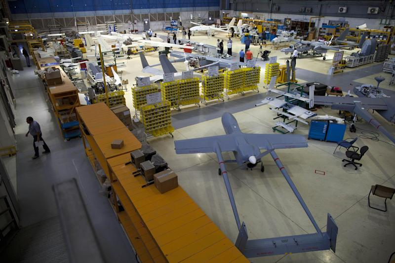 In this picture taken on Monday, May 28, 2013, drones are seen in a hangar at Israel Aerospace Industries, near Tel Aviv. In an expansive hangar in central Israel, workers toil on one of the world's most contentious aircraft, fitting dozens of drones with advanced sensors, cameras and lasers before they are shipped to militaries worldwide. Whereas drones are criticized elsewhere for being morally and legally objectionable, in Israel they are a source of pride. Israel has emerged as the world's leading exporter of the aircraft, putting it in a key position as the industry grows worldwide.(AP Photo/Oded Balilty)