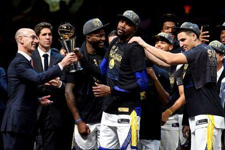 Jun 8, 2018; Cleveland, OH, USA; NBA commissioner Adam Silver presents the Golden State Warriors forward Kevin Durant (35) Bill Russell NBA Finals Most Valuable Player Award after beating the Cleveland Cavaliers in game four of the 2018 NBA Finals at Quicken Loans Arena. Mandatory Credit: Kyle Terada-USA TODAY Sports
