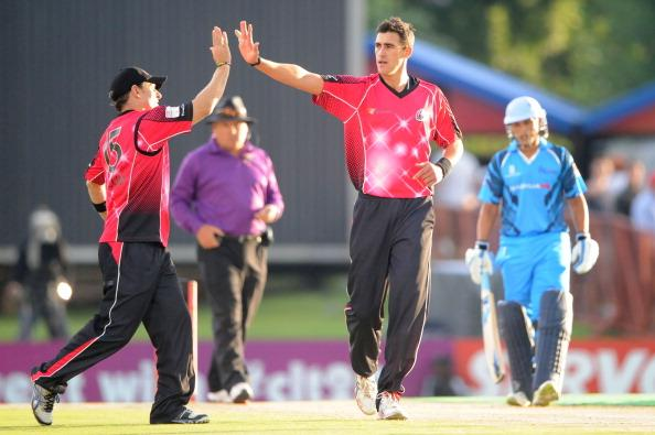 PRETORIA, SOUTH AFRICA - OCTOBER 26: (SOUTH AFRICA OUT) Mitchell Starc (C) celebrates the wicket if Heino Kuhn with a team-mate during the Karbonn Smart CLT20 Semi Final match between Nashua Titans and Sydney Sixers at SuperSport Park on October 26, 2012 in Pretoria, South Africa (Photo by Duif du Toit/Gallo Images/Getty Images)