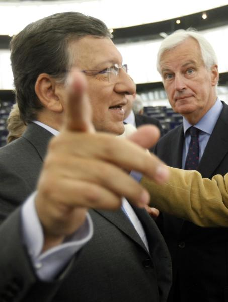 President of the European Commission Jose Manuel Barroso, left, gestures, with Michel Barnier, commissioner for interior market in the background, Wednesday, Sept 12, 2012, at the European Parliament in Strasbourg, eastern France. The European Commission wants the European Central Bank to be the supervisor for all the banks in the 17 countries that use the euro and have the power to fine institutions. (AP Photo/Christian Lutz)
