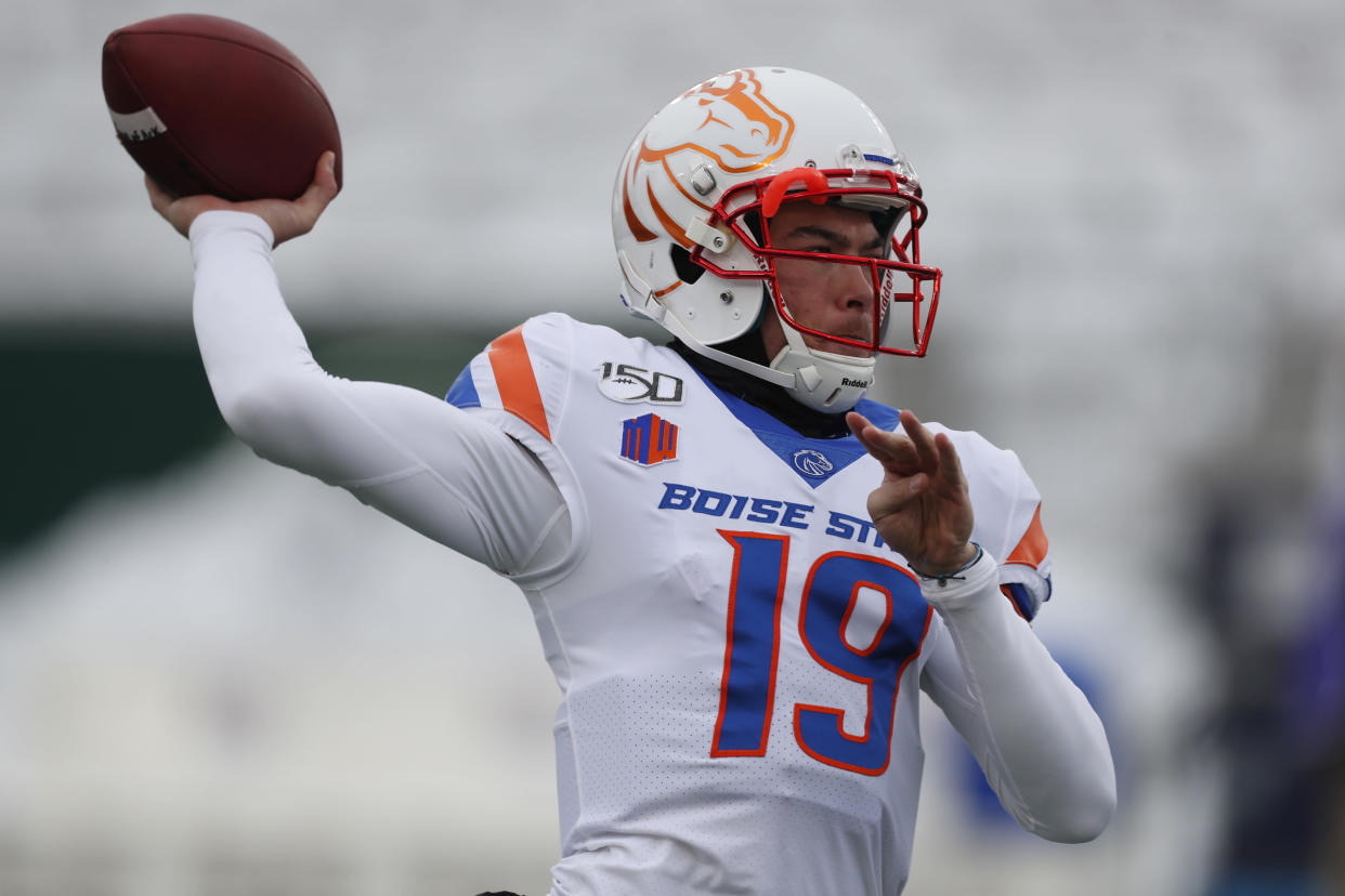 Boise State quarterback Hank Bachmeier (19) warms up before the first half of an NCAA college football game Friday, Nov. 29, 2019, in Fort Collins, Colo. (AP Photo/David Zalubowski)