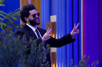 The Weeknd gestures to the crowd after accepting the top artist award at the Billboard Music Awards on Sunday, May 23, 2021, at the Microsoft Theater in Los Angeles. (AP Photo/Chris Pizzello)