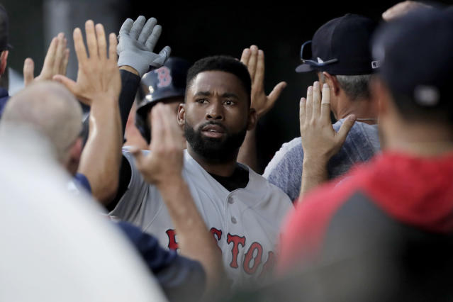 Boston Red Sox's Jackie Bradley Jr. is greeted in the dugout after hitting a three-run home run off Baltimore Orioles starting pitcher Thomas Eshelman during the second inning of a baseball game, Saturday, July 20, 2019, in Baltimore. (AP Photo/Julio Cortez)