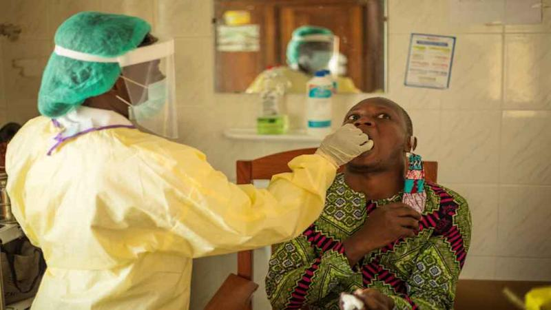 A teacher is tested at the Cadjèhoun Health Center in Cotonou on May 9, 2020.