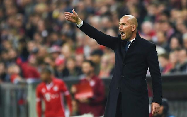 <span>Zinedine Zidane on the touchline at the Allianz Arena</span> <span>Credit:  EPA/FILIP SINGER </span>