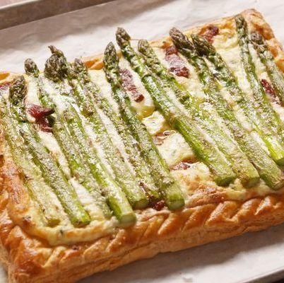 """<p>This cheesy tart is the ultimate brunch party staple.</p><p>Get the <a href=""""https://www.delish.com/uk/cooking/recipes/a35359538/bacon-asparagus-tart-recipe/"""" rel=""""nofollow noopener"""" target=""""_blank"""" data-ylk=""""slk:Bacon-Asparagus Tart"""" class=""""link rapid-noclick-resp"""">Bacon-Asparagus Tart</a> recipe.</p>"""