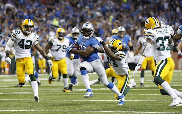 The Green Bay Packers defense closes in on Detroit Lions running back Reggie Bush (21) after his 23-yard run during the second quarter of an NFL football game at Ford Field in Detroit, Thursday, Nov. 28, 2013. (AP Photo/Rick Osentoski)