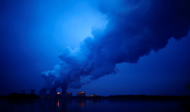 FILE PHOTO: Water vapour rises from the cooling towers of the Jaenschwalde lignite-fired power plant of Lausitz Energie Bergbau AG (LEAG) in Jaenschwalde