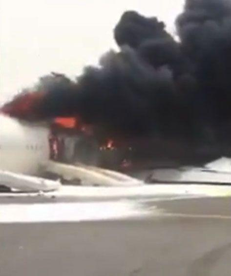 Thick, black plumes of smoke are seen billowing out of the aircraft. Photo: Twitter