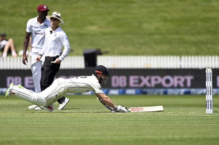 New Zealand batsman Kane Williamson dives to make his ground during play on day one of the first cricket test against the West Indies in Hamilton, New Zealand, Thursday, Dec. 3, 2020. (Andrew Cornaga/Photosport via AP)