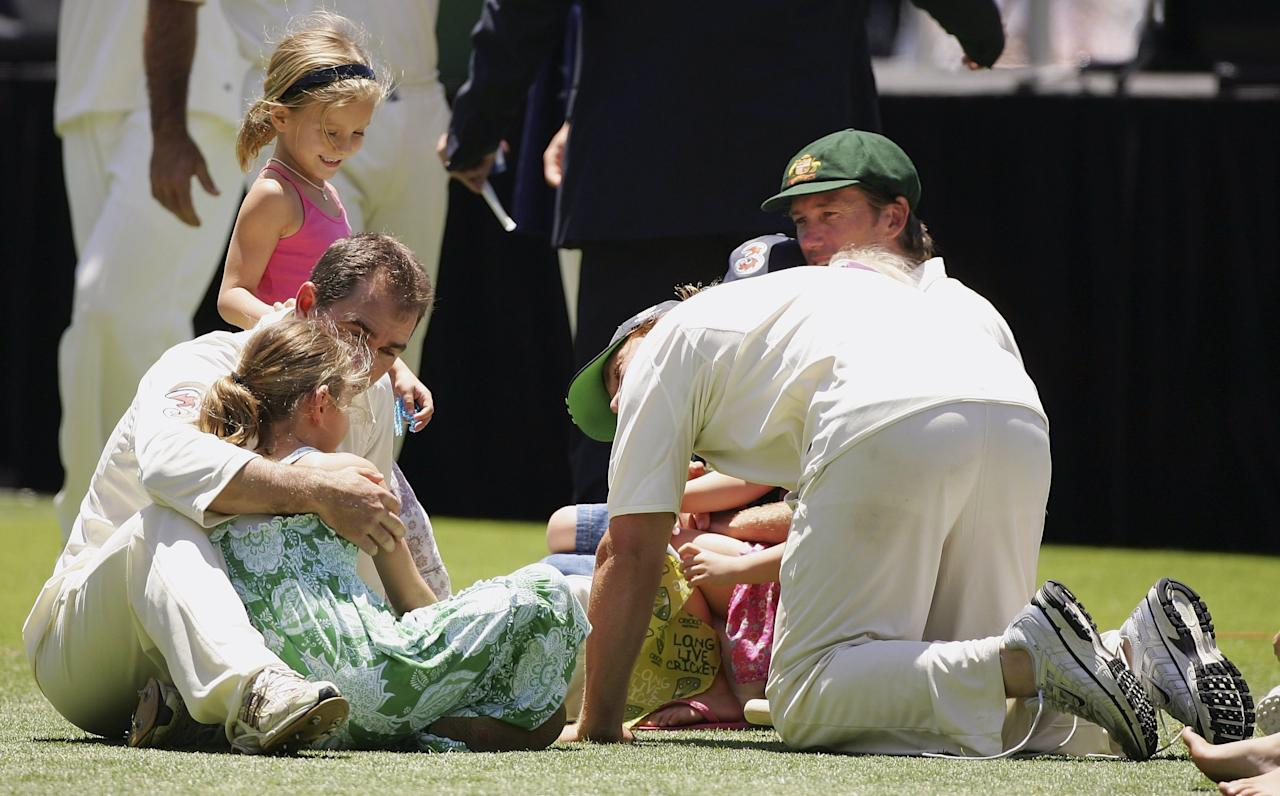SYDNEY, AUSTRALIA - JANUARY 05:  Justin Langer, Shane Warne and Glenn McGrath of Australia play with their children after winning the fifth Ashes Test Match between Australia and England at the Sydney Cricket Ground on January 5, 2007 in Sydney, Australia.  (Photo by Cameron Spencer/Getty Images)