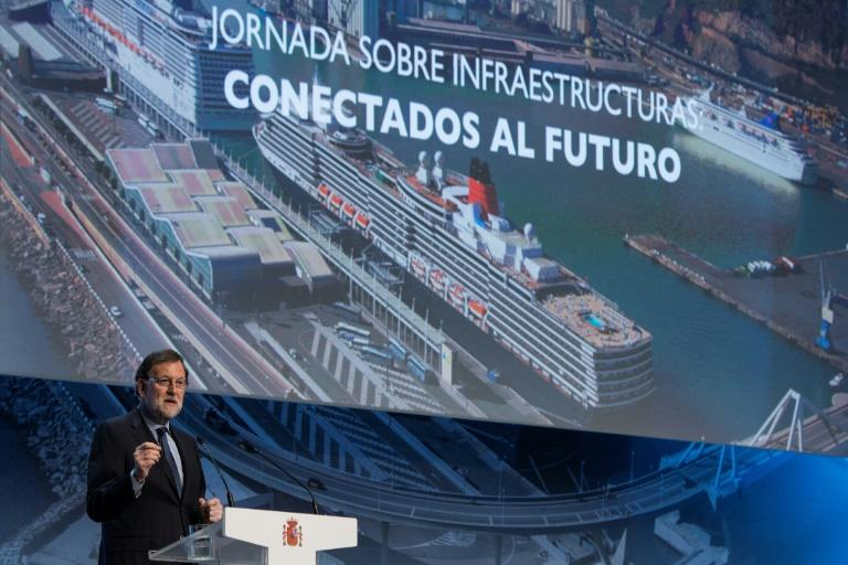 "Spain's Prime Minister Mariano Rajoy makes the opening speech during a conference on infrastructure under the slogan ""Connected to the future"" in Barcelona on March 28, 2017"
