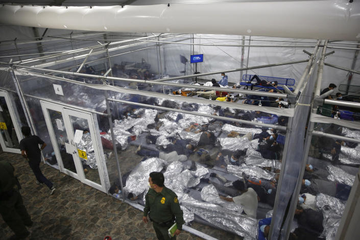 FILE - In this March 30, 2021, file photo, young minors lie inside a pod at the Donna Department of Homeland Security holding facility, the main detention center for unaccompanied children in the Rio Grande Valley run by U.S. Customs and Border Protection (CBP), in Donna, Texas. The Biden administration says the number of unaccompanied migrant children housed at its largest emergency shelter has dropped by more than 40% since mid-June. (AP Photo/Dario Lopez-Mills, Pool, File)