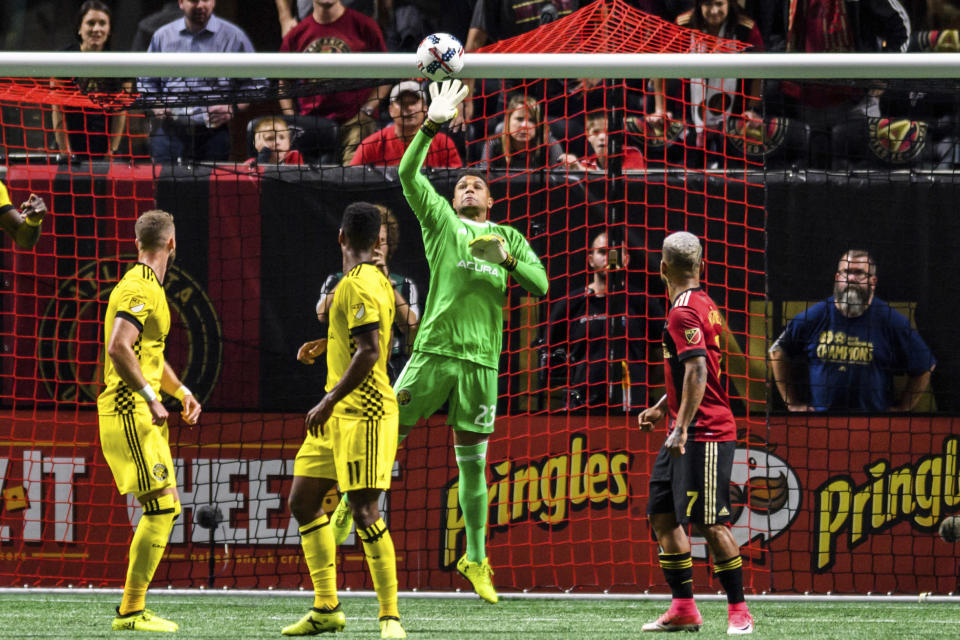 Columbus Crew goalkeeper Zack Steffen (23) defends the goal during the first half of an MLS playoff soccer game against Atlanta United, in Atlanta, Thursday, Oct. 26, 2017. (AP Photo/Danny Karnik)