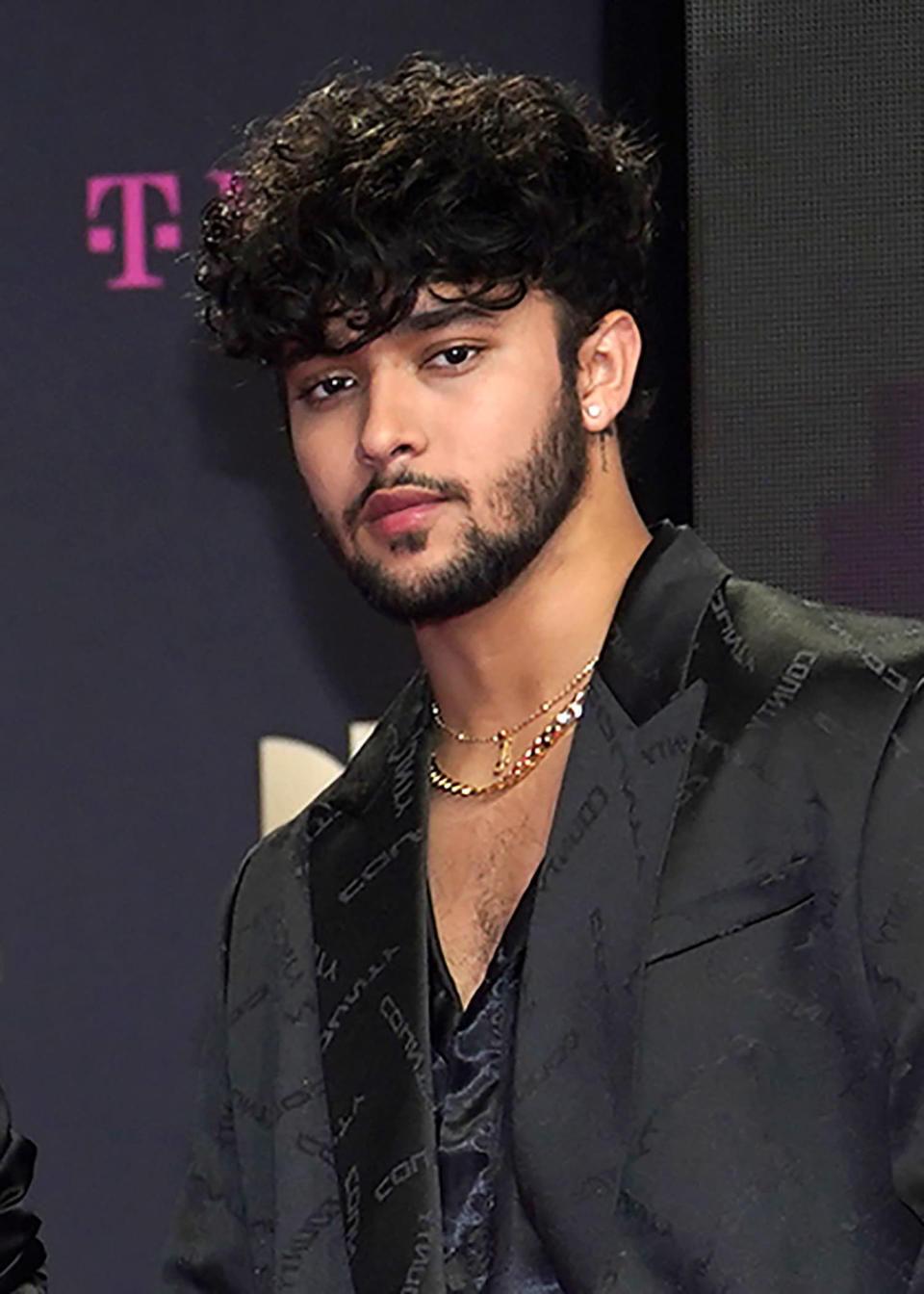 File - This Feb. 18, 2021, file photo shows Joel Pimentel, of CNCO, arriving at Premio Lo Nuestro in Miami. The Latin American boy band CNCO is downsizing. The group announced on its official Instagram page Sunday, May 9, 2021, that 22-year-old Pimentel is leaving the band, making the successful quintet a quartet. (AP Photo/Lynne Sladky, File)