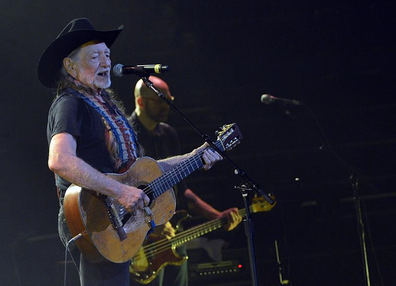 NASHVILLE, TN - APRIL 16:  Willie Nelson performs during Keith Urban's Fourth annual We're All For The Hall benefit concert at Bridgestone Arena on April 16, 2013 in Nashville, Tennessee.  (Photo by Rick Diamond/Getty Images for the Country Music Hall of Fame and Museum)