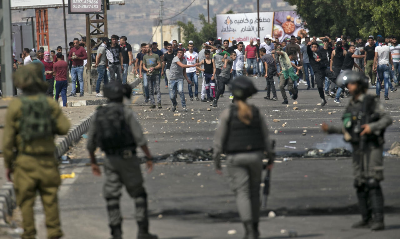 """<p>Palestinians clash with Israeli security forces after a protest marking Nakba, or """"catastrophe"""", commemorating the more than 700,000 Palestinians who fled or were expelled in the 1948 war surrounding Israel's creation, and against the US' relocation of its embassy from Tel Aviv to Jerusalem, at the Hawara checkpoint south of Nablus on May 15, 2018. (Photo: Jaafar Ashtiyeh/ AFP/Getty Images) </p>"""