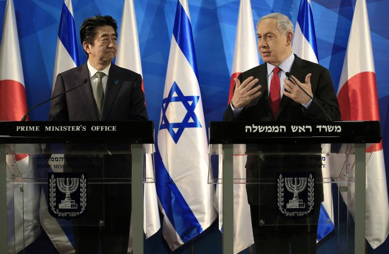 Japan's Prime Minister Abe and his Israeli counterpart Netanyahu hold a joint news conference in Jerusalem