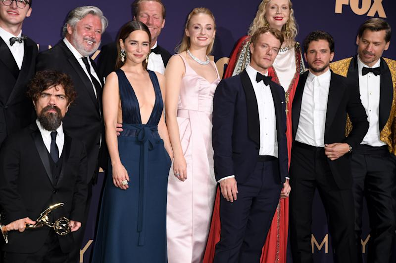 "(l-R) Actors Isaac Hempstead Wright, Peter Dinklage, Conleth Hill, Emilia Clarke, Iain Glen, Sophie Turner, Alfie Allen, Gwendoline Christie, Kit Harington and Nicolaj Coster-Waldau pose with the Emmy for Outstanding Drama Series ""Game Of Thrones"" during the 71st Emmy Awards at the Microsoft Theatre in Los Angeles on September 22, 2019. (Photo by Robyn Beck / AFP) (Photo credit should read ROBYN BECK/AFP via Getty Images)"