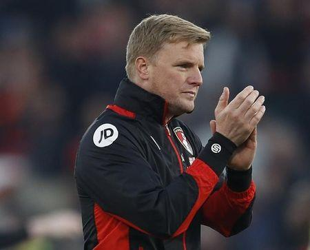 Bournemouth manager Eddie Howe applauds fans after the match