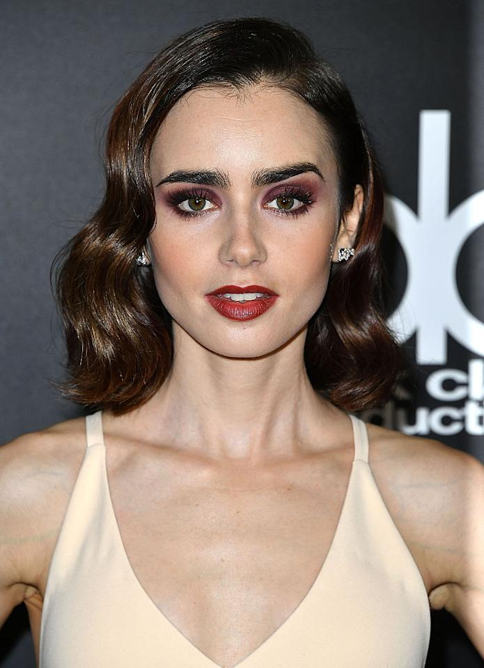 "<p>Talk about drama! Lily Collins arrived at the 20th Annual Hollywood Film Awards with her brunette locks styled in vintage waves, eyelids painted in plum shadow, and burgundy lipstick. <em>For a bold eye look like Collins's, try <a rel=""nofollow"" href=""http://www.ulta.com/nude-matte-eyeshadow?productId=xlsImpprod4141605&sku=2242548"">NYX Cosmetics Nude Matte Eye Shadow in Skinny Dip</a></em>, $5. (Photo: Steve Granitz/WireImage) </p>"