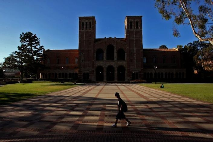 "A student walks in the courtyard in front of Royce Hall at the UCLA campus in Westwood. <span class=""copyright"">(Genaro Molina / Los Angeles Times)</span>"